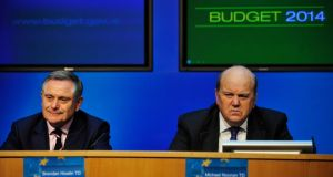 Minister for Finance Michael Noonan (right) and Minister for Public Expenditure and Reform Brendan Howlin at a post-budget press conference. photograph: aidan crawley