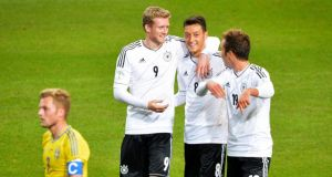 Germany's Andre Schuerrle (L) celebrates his goal against Sweden with teammates Mesut Ozil (C) and Mario Goetze. Photograph: Jonas Ekstromer/Reuters