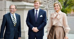 Dutch King Willem-Alexander (centre) and Queen Maxima  are welcomed by Swedish speaker of parliament Per Westerberg   in Stockholm on Monday. Photograph: Reuters