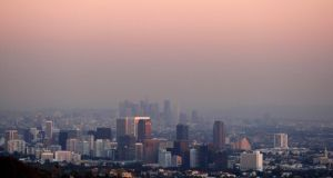 Smog over  downtown Los Angeles. Outdoor air pollution has been officially classified as carcinogenic by the World Health Organisation. Photograph:  Reuters.