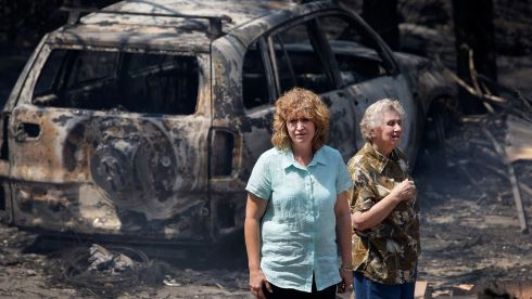 Leanne Brown and her mother Rosemary Booth inspect the remains of Ms Brown's home following a bush fire in Winmalee, Australia. Photograph: Lisa Maree Williams/Getty Images