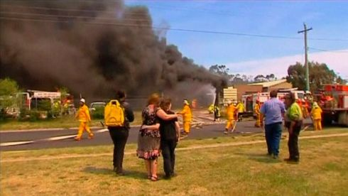 People look on as firefighters with the New South Wales Rural Fire Service fight a fire at a property in Lithgow, in this still frame taken from an October 17th, 2013 video provided by Seven Network Australia.  Photograph: Reuters