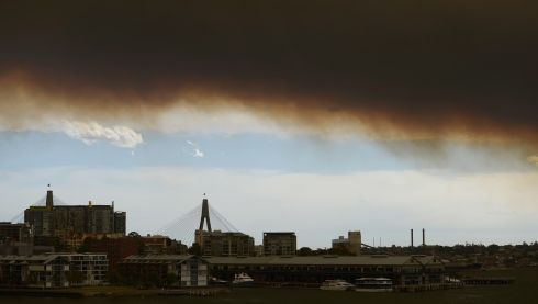 Smoke over the Anzac Bridge and surrounding areas as bushfires rage across New South Wales. Photograph: Brett Hemmings/Getty Images