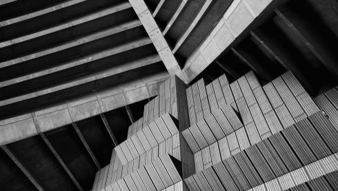 Detail of the plain brush box timber wall and concrete ceiling of the exterior of the concert hall. Photograph: Cameron Spencer/Getty Images