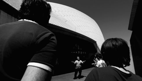 A tour guide fills tourists in outside Sydney Opera House. Photograph: Cameron Spencer/Getty Images