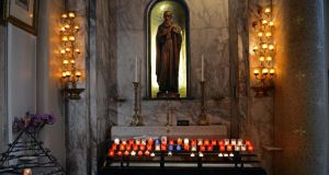 Prayers of the faithful: the shrine of St Jude at the Church of Our Lady of Mount Carmel. Photograph: Eric Luke