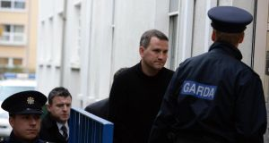 Graham Dwyer (centre in black) being brought into Dun Laoghaire District Court this morning where he was charged with the murder of Elaine O Hara. Photograph: Cyril Byrne/The Irish Times