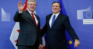 European Commission president Jose Manuel Barroso poses with Canadian prime minister Stephen Harper  ahead of today's meeting at the EU Commission headquarters in Brussels . Photograph: Francois Lenoir/Reuters