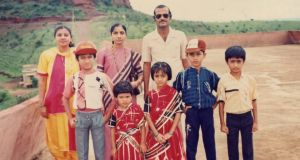 Changing faces: Savita on a family holiday in 1989, when she was about eight years old