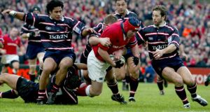 Munster's Anthony Foley dives for the line ahead of several Gloucester players in 2003. Photograph: Morgan Treacy/Inpho