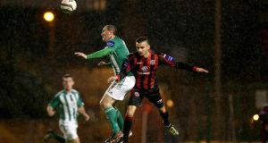 Bohemians' Neil Yadolahi and Jason Byrne of Bray Wanderers during last night's game at  Dalymount Park. Photograph: Ryan Byrne/Inpho