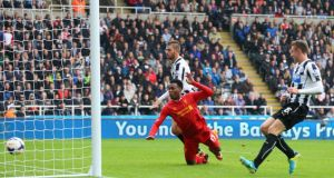 Daniel Sturridge of Liverpool heads home  their second goal during the  Premier League match against  between Newcastle United  at St James' Park. Photograph: Julian Finney/Getty Images