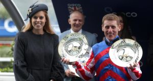 Princess Beatrice presents Royal Diamond jockey Johnny Murtagh with both the jockey and trainer trophies after his success on Royal Diamond  in the Qipco British Champions Long Distance Cup at Ascot. Photograph: Steve Parsons/PA