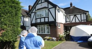 Forensic officers outside the home of the al- Hilli family in Claygate, Surrey, in September 2012. Photograph: Steve Parsons/PA Wire