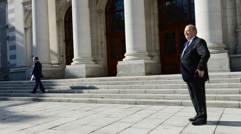 Finance Minister Michael Noonan TD and cabinet colleague Brendan Howlin TD Minister for Public Expenditure and Reform  at Government Buildings for the traditional Budget photocall  before delivering the Budget to the House during the week. Photo: Bryan O'Brien / THE IRISH TIMES