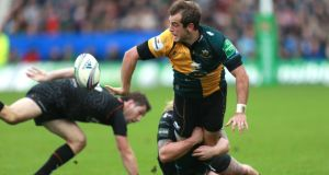 Northampton's Stephen Myler is tackled by Ospreys Richard Hibbard  at Franklins Gardens. Photograph: David Davies/PA Wire