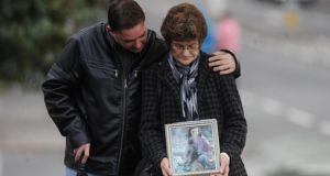 Gina Murray (mother of Leanne Murray killed in Shankill bomb) with her son Gary as they protest on the Crumlin Road in North Belfast. Photograph: Colm Lenaghan/Pacemaker.