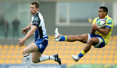 Zebre's David Odiete and Matt Healy of Connacht mid air in the Heineken Cup clash at Stadio XXV Aprile, Parma. Photo : James Crombie / INPHO