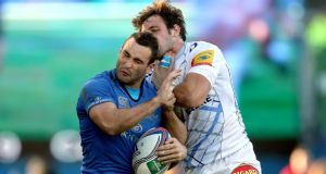 Leinster's Dave Kearney and Remi Lamerat of Castres. The French player was yellow-carded for this tackle. Photograph: Inpho