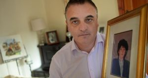 Greg Pepper holds a photograph of his sister Antoinette, who died from septicaemia in St Vincent's hospital in Dublin in 1988 after giving birth in the National Maternity Hospital. Photograph: Dara Mac Dónaill
