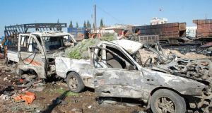 The aftermath of a suicide truck bomb at the eastern entrance of Hama city. The truck was packed with 1.5 tonnes of explosives which killed 30 people and wounded dozens. Photograph: Reuters/Sana/Handout