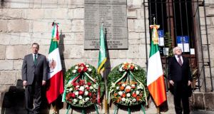 President Michael D Higgins (right) and Mexico's foreign minister José Antonio Meade at a wreath-laying ceremony at a memorial to the Batallón de San Patricio  in Mexico City. Photograph:  Chris Bellew / Fennell Photography