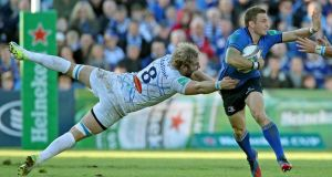 Leinster's man of the match Jimmy Gopperth goes past Antonie Claassen of Castres during the game in the RDS. Photograph: Ryan Byrne/Inpho