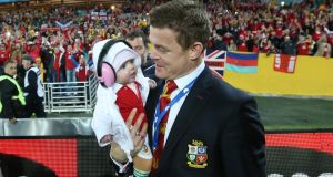 Brian O'Driscoll with his daughter Sadie after the third Lions' test. Photograph: BillyStickland/Inpho