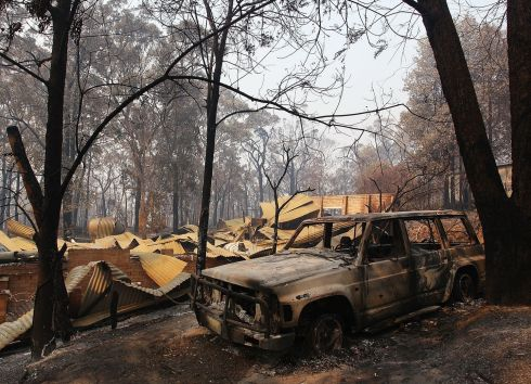 A home destroyed by bushfire in Winmalee, Australia. One man has died and hundreds of properties have been destroyed in bushfires that are devastating the Blue Mountains and Central Coast regions of New South Wales. Photograph: Lisa Maree Williams/Getty Images