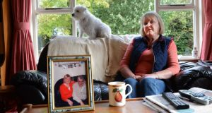 Moira O'Hara with her dog, Maisie, at home with a photograph of her late husband, Martin, in Co Wicklow.Photograph:Cyril Byrne