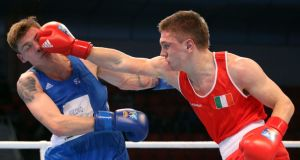 Ireland's Jason Quigley (right) lands a blow on  Aston Brown of Scotland in Almaty. Photograph: Cathal Noonan/Inpho