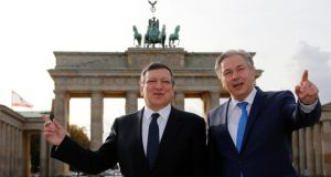 European Commission President José Manuel Barroso (left) and Berlin's mayor Klaus Wowereit at the Brandenburg Gate in Berlin today. Opening the European Parliament's plenary session in Strasbourg, parliament president Martin Schultz said he had been contacted yesterday by Mr Barroso seeking urgent approval for a €2.7 billion supplementary budget for 2013. Photograph: Fabrizio Bensch/Reuters