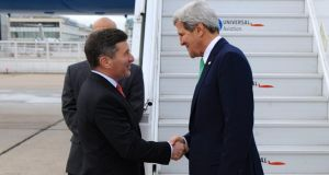 US secretary of state John Kerry shaking hands with US ambassador to France Charles Rivkin upon arriving in Paris yesterday. The National Security Agency has carried out extensive electronic surveillance in France, 'Le Monde' has reported. Photograph: New York Times/US State Department