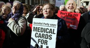 People taking part in a protest on medical cards for those aged 70 and over, outside Leinster House, yesterday. Photograph: Eric Luke