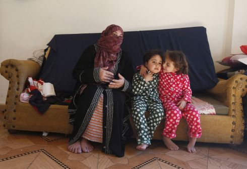 Hanady Rakhan (left) the mother of three-year-old Limar (centre) who was deafened in a bomb blast and Tasnim, in their home in the Badawi refugee camp in Lebanon. Photograph: Danny Lawson/PA Wire