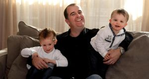 Keith Moran – who was cured of shingles by a faith healer – with his sons Dylan (4) and Jamie (2). Photograph: Cyril Byrne