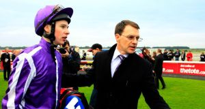 Trainer Aidan O'Brien with his son, jockey Joseph O'Brien, who will team up with Belisarius at Navan today. Photo: Brian Lawless/PA Wire.