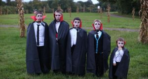 Halloween is a time for mischief and transgression.  Young vampires pose for a photograph before the Shocktober Fest in Crawley, West Sussex. Photograph: Getty Images