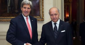 French foreign minister Laurent Fabius welcomes US secretary of State John Kerry on Tuesday at the foreign affairs ministry in Paris. Photograph: Philippe Wojazer/Reuters