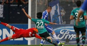Chelsea's Fernando Torres scores against Schalke 04 during last night's match in Gelsenkirchen.