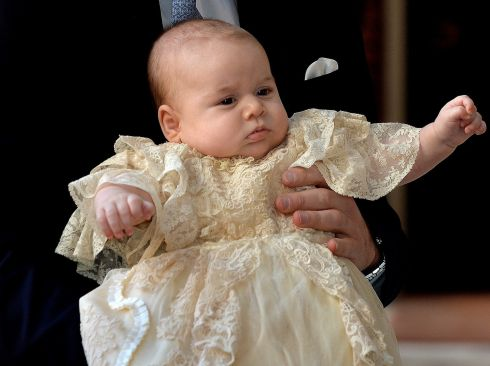 The Duke of Cambridge arrives, holding his son Prince George, at Chapel Royal in St James's Palace in London, ahead of the christening of the three month-old Prince George of Cambridge by the Archbishop of Canterbury: Photograph; John Stillwell/PA Wire