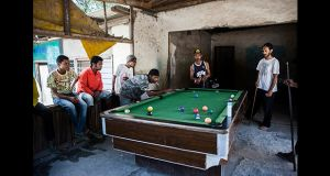 Young men play pool at on old house in Balibo. Photograph: Cedric Arnold/realfeatures.com
