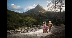 Villagers walk back to their village on a small mountain road in Marobo. Photograph: Cedric Arnold/realfeatures.com