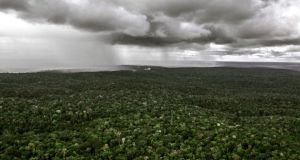 Rain approaching in the Brazilian Amazon rainforest. If greenhouse emissions continue their steady escalation, temperatures across most of the earth will rise to levels with no recorded precedent by the middle of this century, researchers say. Photograph: The New York Times
