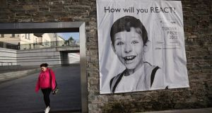 A poster hangs on a wall in Ebrington Square, Derry, the venue of the 2013 Turner Prize. Photograph: Getty Images