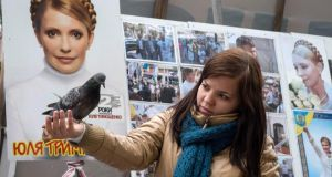 A supporter of jailed Ukrainian ex-prime minister Yulia Tymoshenko feeds a pigeon in a protest tent camp in central Kiev earlier this month.  Photograph: Gleb Garanich/Reuters