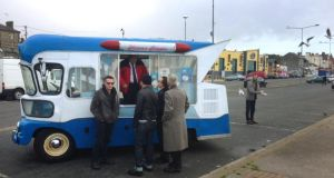 U2 queues for ice-cream on Bray seafront. Photograph: Jason Forde