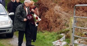 Sophie's parents  after placing a bouqet of flowers by a celtic cross marking the spot wher their daughter  was found murdered. Photograph: Provision