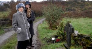 Marguerite Bouniol, Sophie's mother  and her friend Marie Paul Bloc Daudet pause at the memorial cross that marks the spot where Sophie was murdered outside her holiday home at Toormore, West Cork. Photograph: Niall Duffy