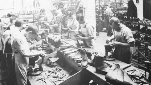Workers at Winstanley's Bootmakers in Dublin appear to ignore the camera and continue working. It is one of the photographs in an exhibition on the working lives of Irish men, women and children in the run up to the 1913 Lockout aon display at the National Photographic Archive. Photograph: National Library of Ireland